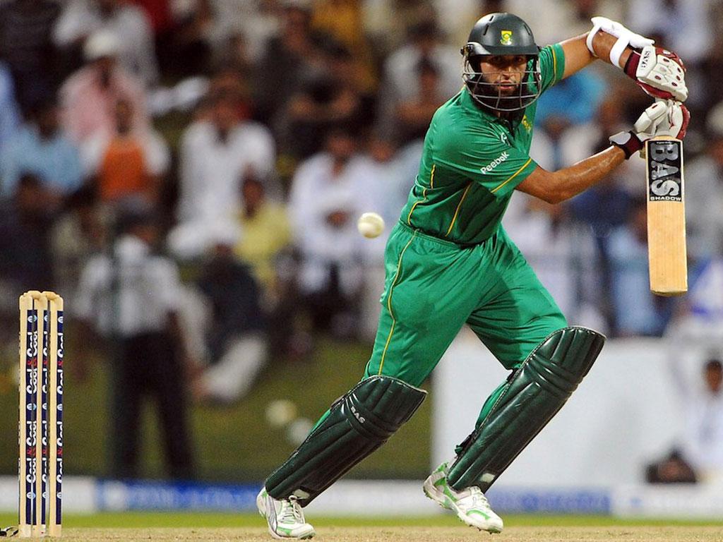Cricketer amla green dress batting stills