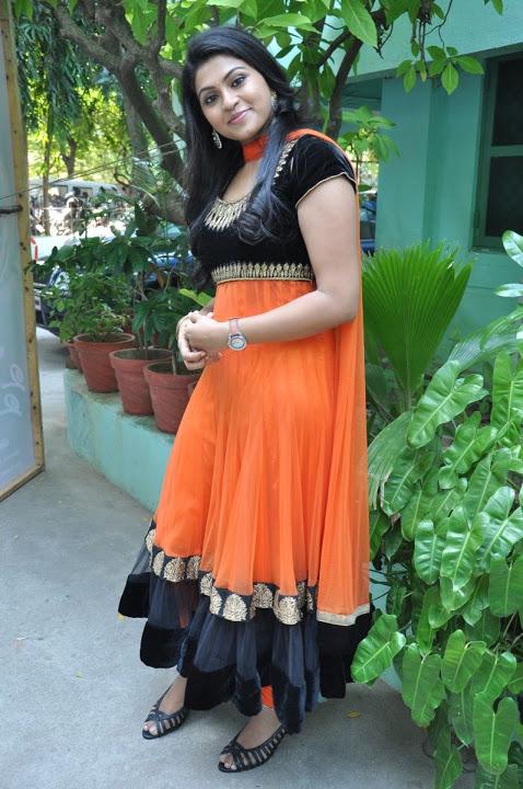 Nandhana orange color dress cute pictures
