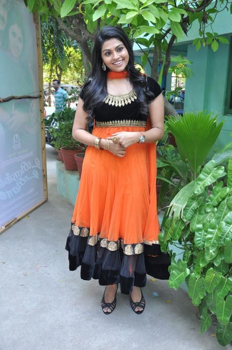 Nandhana orange color dress glamour photos