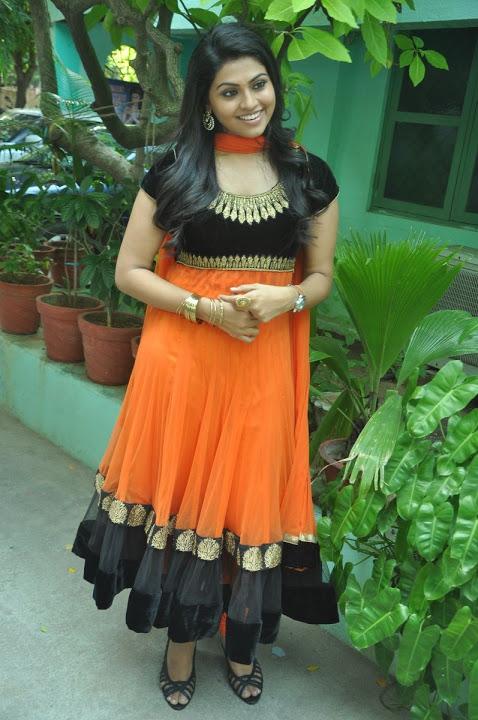 Nandhana orange color dress photoshoot photos