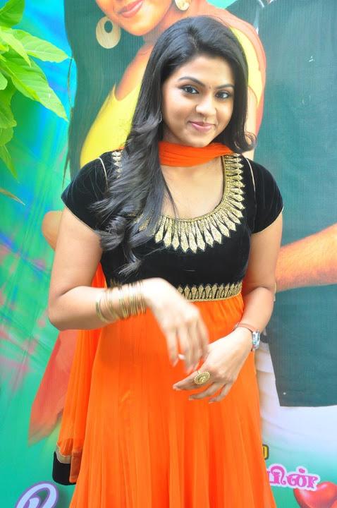 Nandhana orange color dress smile pose photos