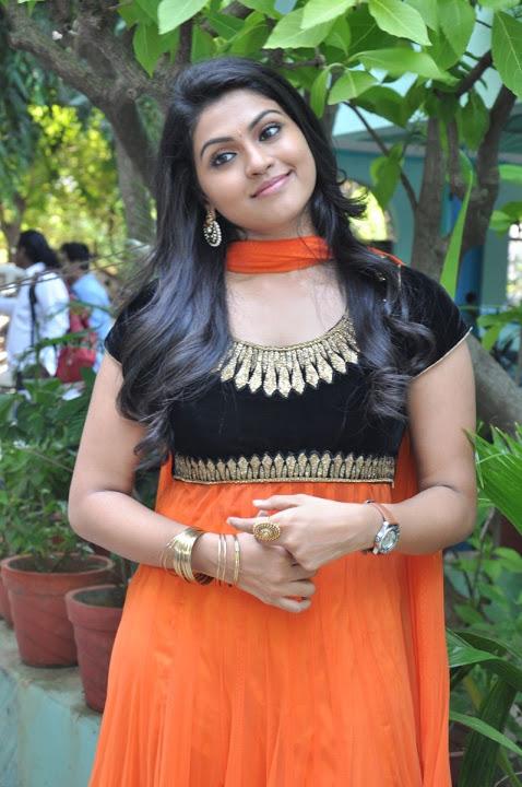 Nandhana orange color dress wide pictures