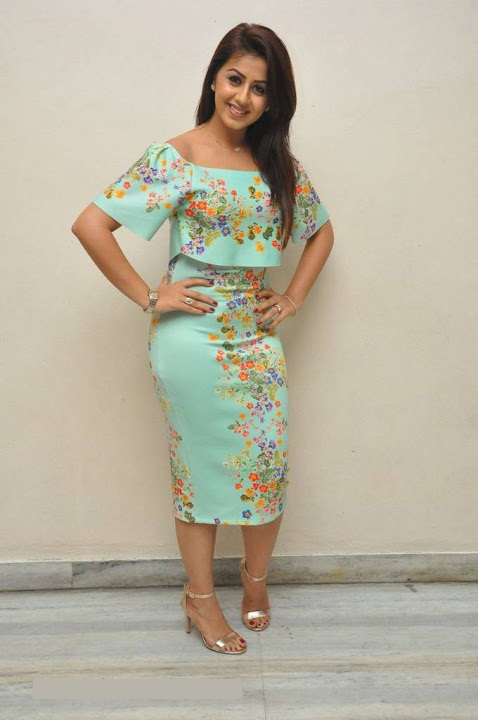 Nikki galrani light green color dress figure photos