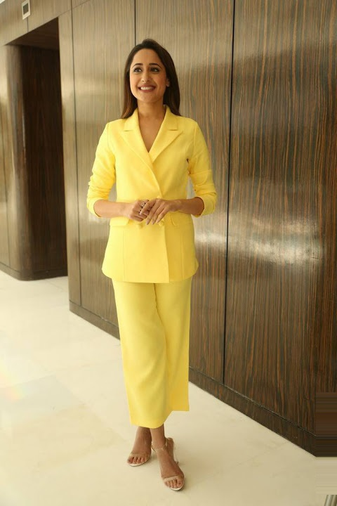 Pragya jaiswal yellow dress interview image