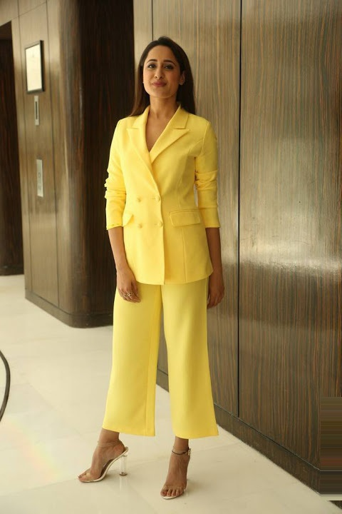 Pragya jaiswal yellow dress modeling photos