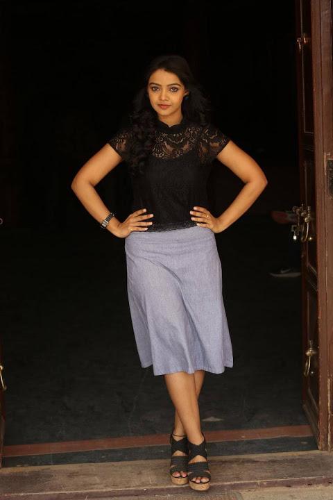 Nitya shetty black dress figure stills
