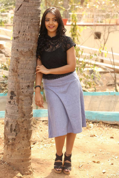 Nitya shetty black dress smile pose