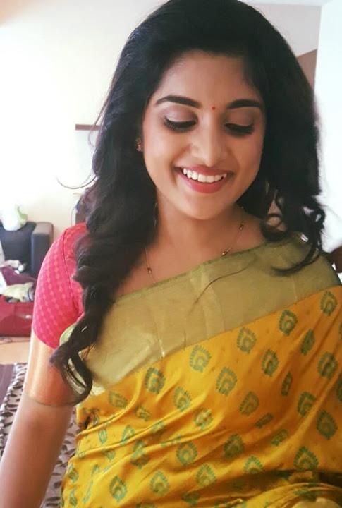 Niveda thomas gold saree pictures