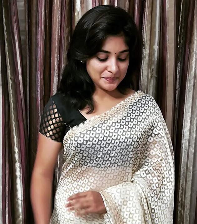 Niveda thomas white saree photos
