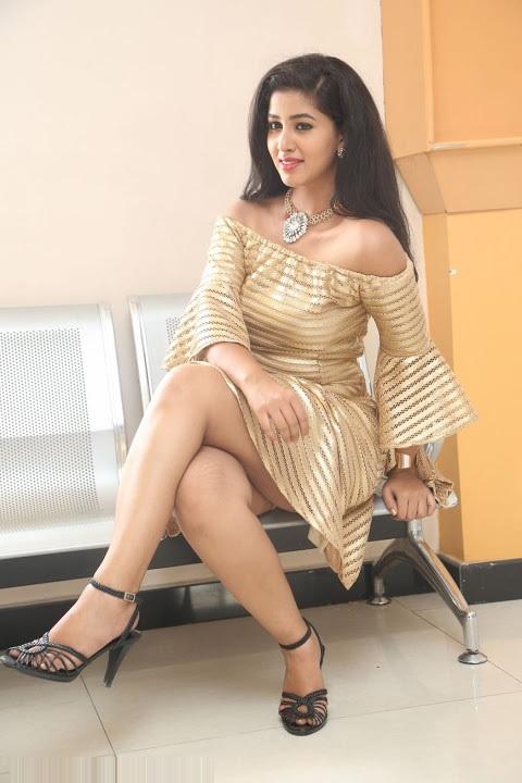 Pavani reddy gold color dress smile pose hd pics