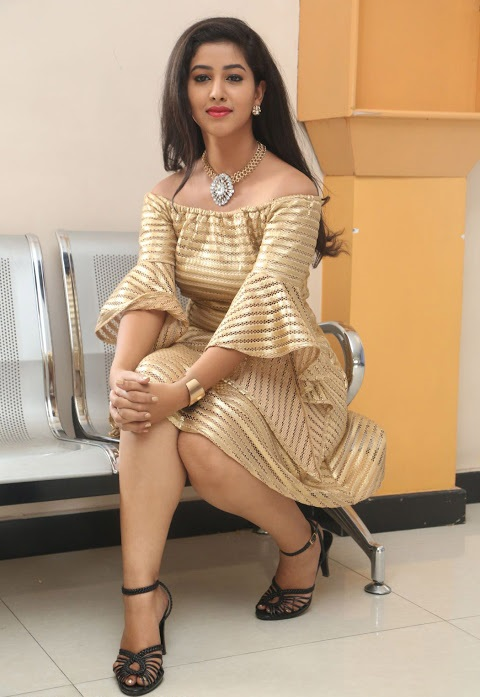 Pavani reddy gold color dress smile pose photos