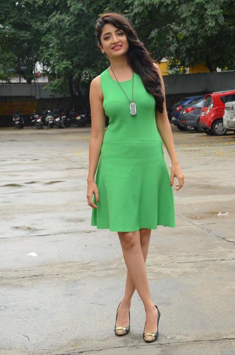 Poonam kaur green dress interview pics