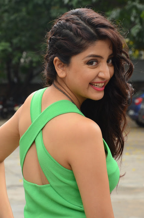 Poonam kaur green dress smile pose pictures