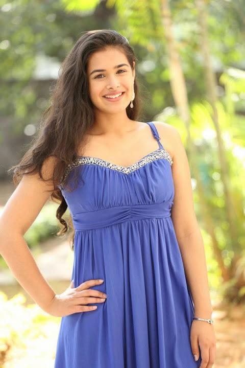 Prasanna blue dress smile pose pics