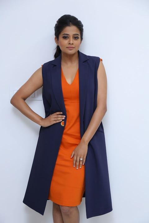 Priyamani press meet hd orange photos